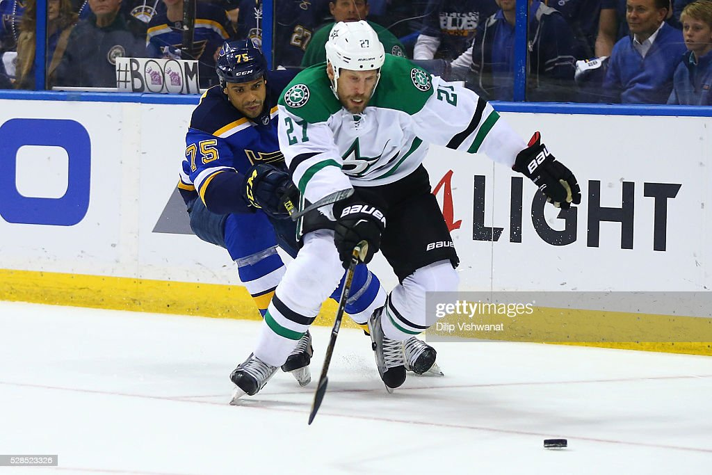 <a gi-track='captionPersonalityLinkClicked' href=/galleries/search?phrase=Ryan+Reaves&family=editorial&specificpeople=4601052 ng-click='$event.stopPropagation()'>Ryan Reaves</a> #75 of the St. Louis Blues and <a gi-track='captionPersonalityLinkClicked' href=/galleries/search?phrase=Travis+Moen&family=editorial&specificpeople=208110 ng-click='$event.stopPropagation()'>Travis Moen</a> #27 of the Dallas Stars chase the puck in Game Four of the Western Conference Second Round during the 2016 NHL Stanley Cup Playoffs at the Scottrade Center on May 5, 2016 in St. Louis, Missouri.