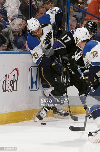 Ryan Reaves of the St Louis Blues battles for the puck with Ethan Moreau of the Los Angeles Kings in an NHL game on November 22 2011 at Scottrade...