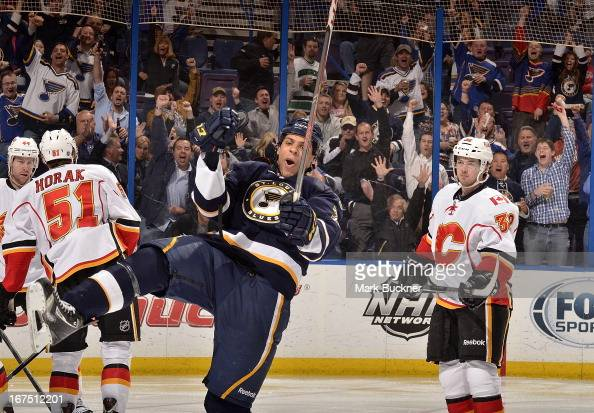 Ryan Reaves of the St Louis Blues celebrates a goal in an NHL game against the Calgary Flames on April 25 2013 at Scottrade Center in St Louis...