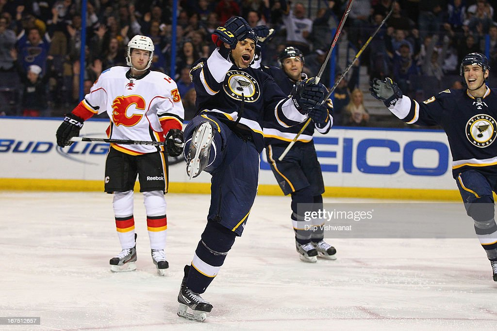 <a gi-track='captionPersonalityLinkClicked' href=/galleries/search?phrase=Ryan+Reaves&family=editorial&specificpeople=4601052 ng-click='$event.stopPropagation()'>Ryan Reaves</a> #75 of the St. Louis Blues celebrates his second goal of the game against the Calgary Flames during the third period at the Scottrade Center on April 25, 2013 in St. Louis, Missouri. The Blues beat the Flames 4-1.