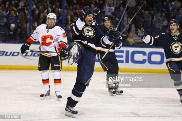 Ryan Reaves of the St Louis Blues celebrates his second goal of the game against the Calgary Flames during the third period at the Scottrade Center...