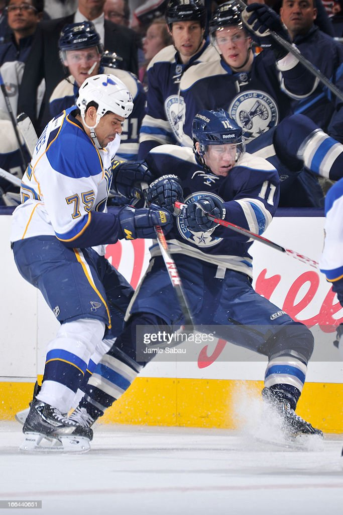 <a gi-track='captionPersonalityLinkClicked' href=/galleries/search?phrase=Ryan+Reaves&family=editorial&specificpeople=4601052 ng-click='$event.stopPropagation()'>Ryan Reaves</a> #75 of the St. Louis Blues checks Matt Calvert #11 of the Columbus Blue Jackets during the third period on April 12, 2013 at Nationwide Arena in Columbus, Ohio. Columbus defeated St. Louis 4-1.
