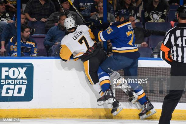 Ryan Reaves of the St Louis Blues checks Matt Cullen of the Pittsburgh Penguins on February 4 2017 in St Louis Missouri