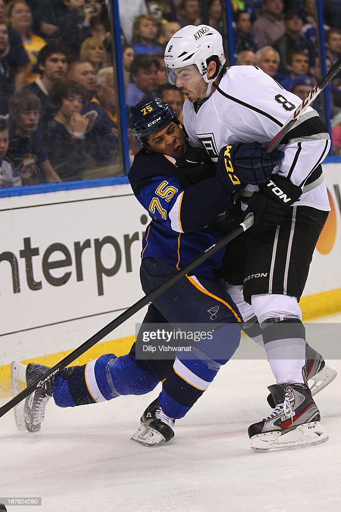 <a gi-track='captionPersonalityLinkClicked' href=/galleries/search?phrase=Ryan+Reaves&family=editorial&specificpeople=4601052 ng-click='$event.stopPropagation()'>Ryan Reaves</a> #75 of the St. Louis Blues collides with <a gi-track='captionPersonalityLinkClicked' href=/galleries/search?phrase=Drew+Doughty&family=editorial&specificpeople=2085761 ng-click='$event.stopPropagation()'>Drew Doughty</a> #8 of the Los Angeles Kings in Game One of the Western Conference Quarterfinals during the 2013 NHL Stanley Cup Playoffs at the Scottrade Center on April 30, 2013 in St. Louis, Missouri. The Blues beat the Kings 2-1 in overtime.