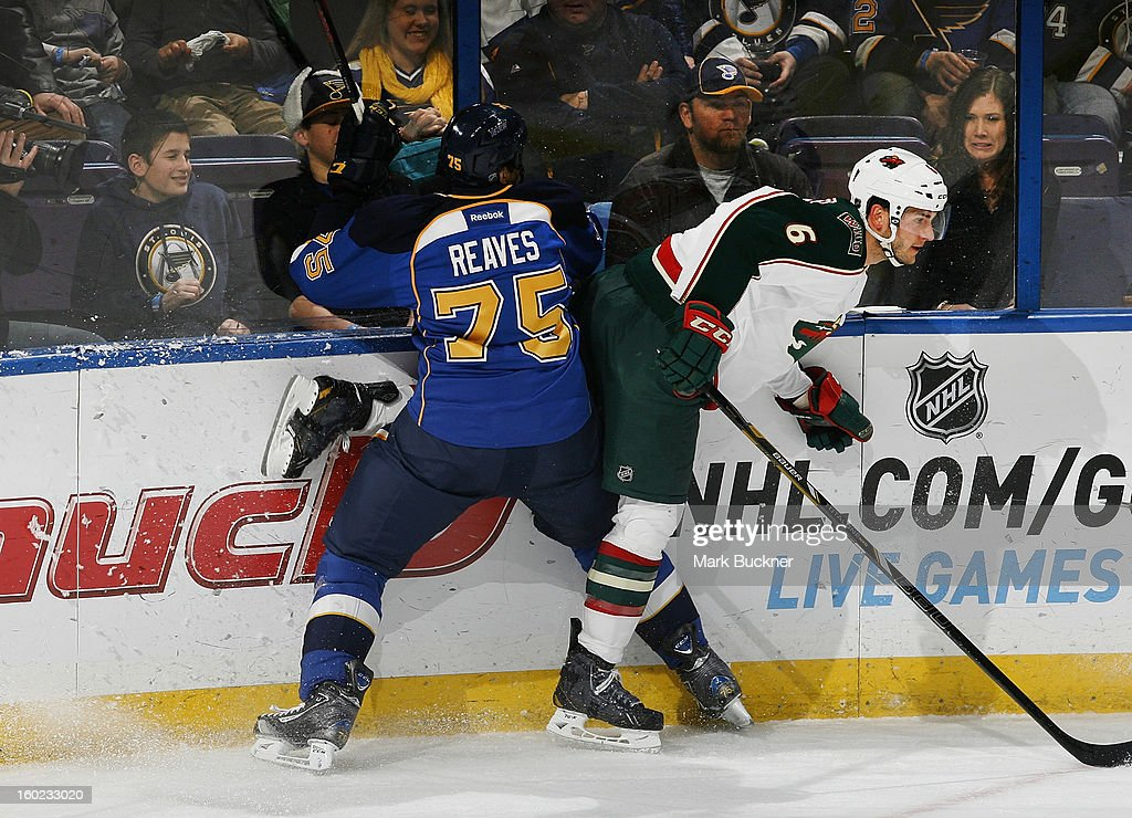 Ryan Reaves #75 of the St. Louis Blues collides with Marco Scandella #6 of the Minnesota Wild in an NHL game on January 27, 2013 at Scottrade Center in St. Louis, Missouri.