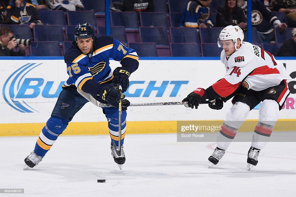Ryan Reaves of the St Louis Blues controls the puck against Mark Borowiecki of the Ottawa Senators at the Scottrade Center on January 4 2016 in St...