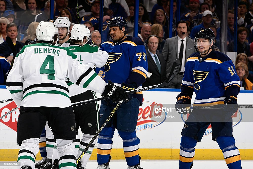 <a gi-track='captionPersonalityLinkClicked' href=/galleries/search?phrase=Ryan+Reaves&family=editorial&specificpeople=4601052 ng-click='$event.stopPropagation()'>Ryan Reaves</a> #75 of the St. Louis Blues exchanges words with <a gi-track='captionPersonalityLinkClicked' href=/galleries/search?phrase=Kris+Russell&family=editorial&specificpeople=879805 ng-click='$event.stopPropagation()'>Kris Russell</a> #2 of the Dallas Stars in Game Four of the Western Conference Second Round during the 2016 NHL Stanley Cup Playoffs at the Scottrade Center on May 5, 2016 in St. Louis, Missouri.