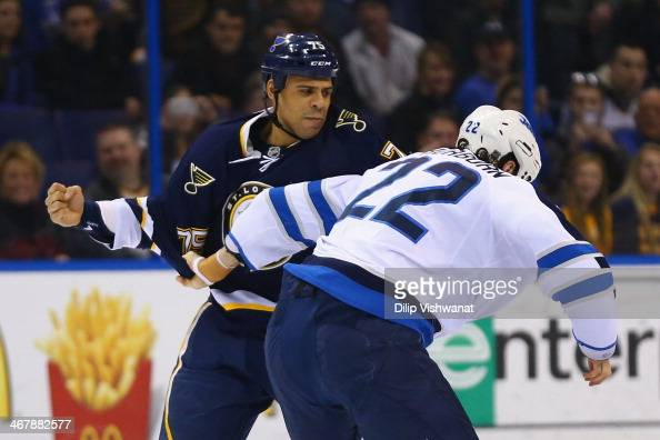 Ryan Reaves of the St Louis Blues fights with Chris Thorburn of the Winnipeg Jets at the Scottrade Center on February 8 2014 in St Louis Missouri