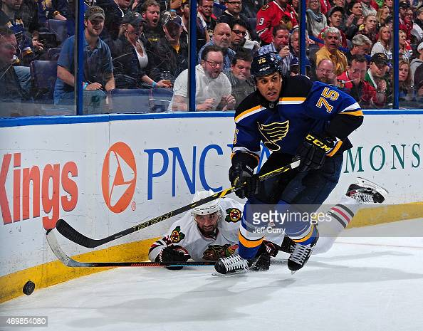 Ryan Reaves of the St Louis Blues handles the puck against the Chicago Blackhawks on April 9 2015 at the Scottrade Center in St Louis Missouri