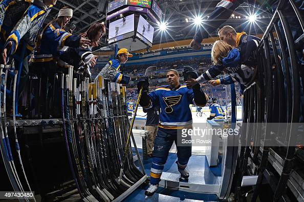 Ryan Reaves of the St Louis Blues high fives fans before a game against the Winnipeg Jets on November 16 2015 at Scottrade Center in St Louis Missouri