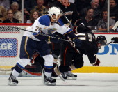 Ryan Reaves of the St Louis Blues knocks down Saku Koivu of the Anaheim Ducks at the Honda Center on January 12 2011 in Anaheim California