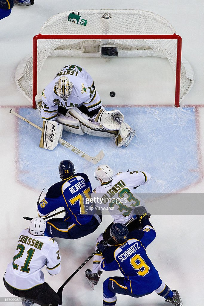 <a gi-track='captionPersonalityLinkClicked' href=/galleries/search?phrase=Ryan+Reaves&family=editorial&specificpeople=4601052 ng-click='$event.stopPropagation()'>Ryan Reaves</a> #75 of the St. Louis Blues scores a goal against <a gi-track='captionPersonalityLinkClicked' href=/galleries/search?phrase=Kari+Lehtonen&family=editorial&specificpeople=211612 ng-click='$event.stopPropagation()'>Kari Lehtonen</a> #32 of the Dallas Stars during the second period at the Scottrade Center on April 19, 2013 in St. Louis, Missouri. The Blues beat the Stars 2-1.