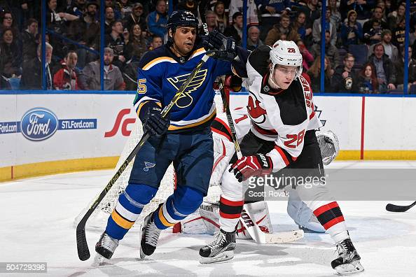 Ryan Reaves of the St Louis Blues skates against Damon Severson of the New Jersey Devils on January 12 2016 at Scottrade Center in St Louis Missouri