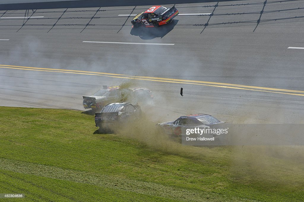 <a gi-track='captionPersonalityLinkClicked' href=/galleries/search?phrase=Ryan+Reed&family=editorial&specificpeople=3908663 ng-click='$event.stopPropagation()'>Ryan Reed</a>, driver of the #16 ADA Drive to Stop Diabetes presented by Lilly Diabetes Ford, Brian Scott, driver of the #2 Shore Lodge Chevrolet, and <a gi-track='captionPersonalityLinkClicked' href=/galleries/search?phrase=Trevor+Bayne&family=editorial&specificpeople=5533943 ng-click='$event.stopPropagation()'>Trevor Bayne</a>, driver of the #6 AdvoCare Ford, crash during the NASCAR Nationwide Series Aaron's 312 at Talladega Superspeedway on May 3, 2014 in Talladega, Alabama.