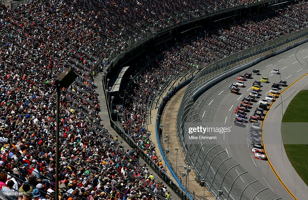 Ryan Reed driver of the ADA Drive to Stop Diabetes presented by Lilly Diabetes Ford leads a pack of cars during the NASCAR Nationwide Series Aaron's...