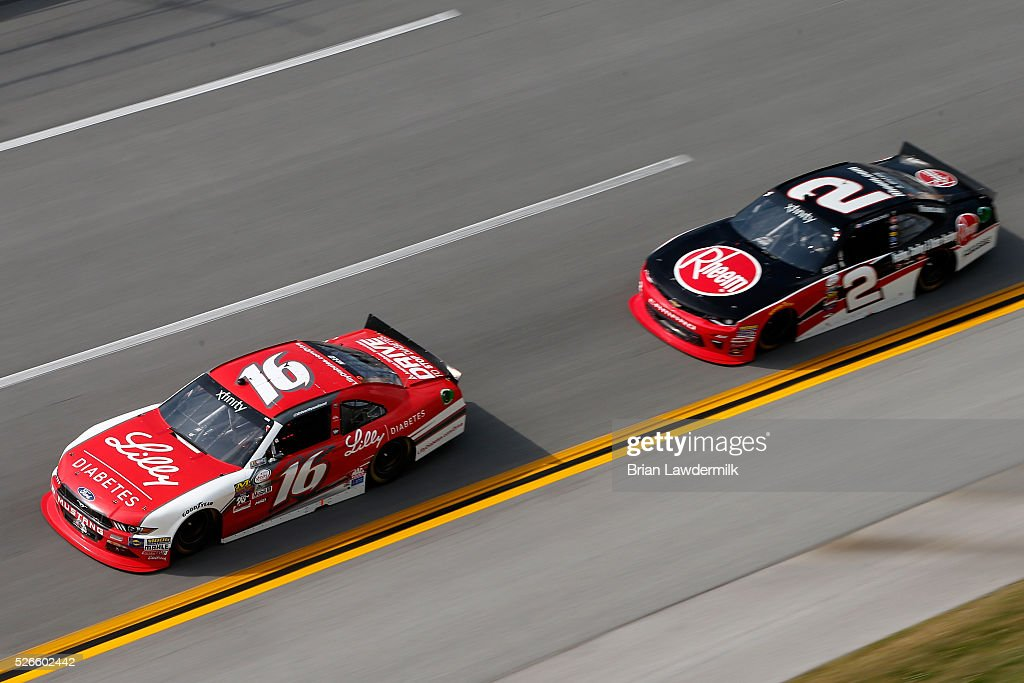 <a gi-track='captionPersonalityLinkClicked' href=/galleries/search?phrase=Ryan+Reed&family=editorial&specificpeople=3908663 ng-click='$event.stopPropagation()'>Ryan Reed</a>, driver of the #16 Lilly Diabetes/American Diabetes Assoc Ford, leads <a gi-track='captionPersonalityLinkClicked' href=/galleries/search?phrase=Austin+Dillon&family=editorial&specificpeople=5075945 ng-click='$event.stopPropagation()'>Austin Dillon</a>, driver of the #2 Rheem Chevrolet, during the NASCAR XFINITY Series Sparks Energy 300 at Talladega Superspeedway on April 30, 2016 in Talladega, Alabama.