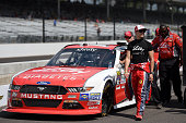 Ryan Reed driver of the Lilly Diabetes/American Diabetes Association Ford stands on the grid during qualifying for the NASCAR XFINITY Series Lilly...