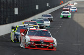 Ryan Reed driver of the Lilly Diabetes/American Diabetes Association Ford leads a pack of cars during the NASCAR XFINITY Series Lilly Diabetes 250 at...
