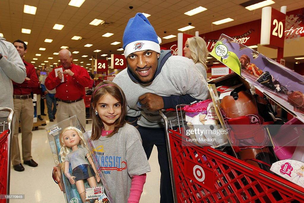 Ryan Reid of the Oklahoma City Thunder shops for toys during a holiday shopping spree with ten families from the Grandparents Raising Grandchildren program on Tuesday, Dec. 13 at a Target store in northwest Oklahoma City in Oklahoma City, Oklahoma.