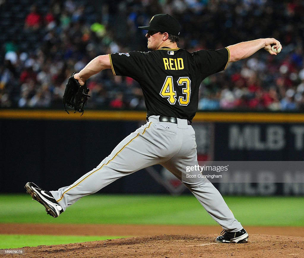 Ryan Reid #43 of the Pittsburgh Pirates pitches against the Atlanta Braves at Turner Field on June 4, 2013 in Atlanta, Georgia.