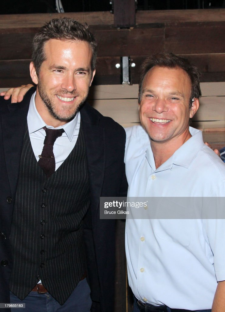 Ryan Reynolds and Norbert Leo Butz pose backstage (as Ryan Reynolds and wife Blake Lively celebrate their 1st wedding anniversary) at the musical 'Big Fish' on Broadway at The Neil Simon Theater on September 6, 2013 in New York City.
