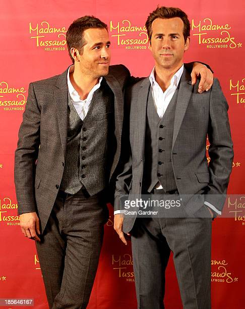 Ryan Reynolds poses side by side with his Madame Tussauds Hollywood wax figure on October 21 2013 in New Orleans Louisiana