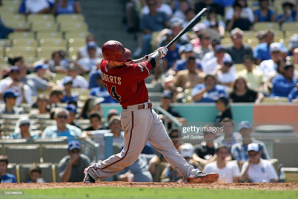 Ryan Roberts #14 of the Arizona Diamondbacks singles against the Los Angeles Dodgers in the eighth inning of the game at Dodger Stadium on July 31, 2011 in Los Angeles, California.