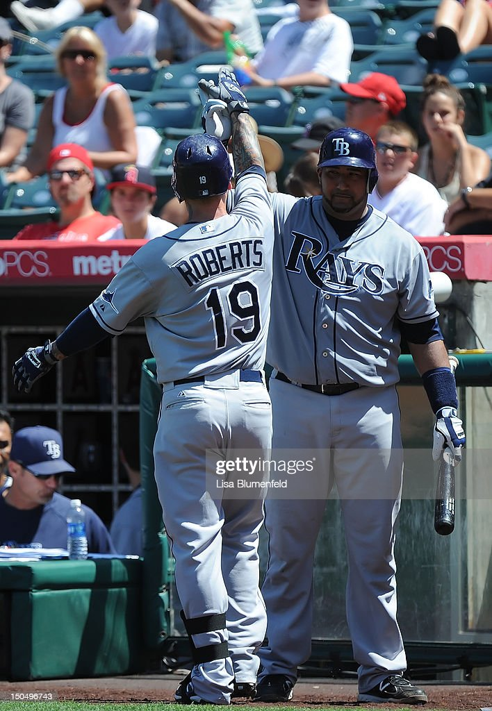 Ryan Roberts #19 of the Tampa Bay Rays celebrates with teammate <a gi-track='captionPersonalityLinkClicked' href=/galleries/search?phrase=Jose+Molina&family=editorial&specificpeople=206365 ng-click='$event.stopPropagation()'>Jose Molina</a> #28 after hitting a two run homerun in the fifth inning against the Los Angeles Angels of Anaheim at Angel Stadium of Anaheim on August 19, 2012 in Anaheim, California.