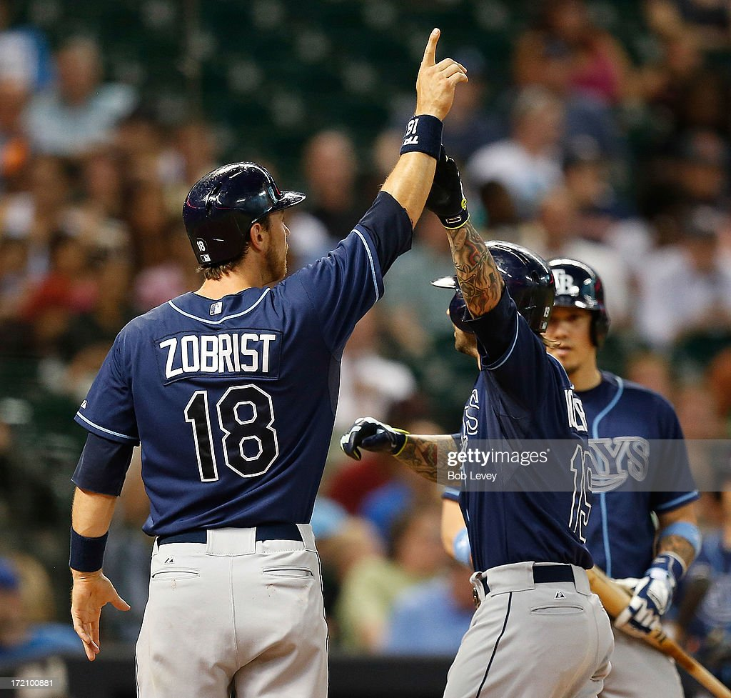 Ryan Roberts #19 of the Tampa Bay Rays receives congratulations from Ben Zobrist #18 of the Tampa Bay Rays after hitting a two-run home run in the third inning against the Houston Astros at Minute Maid Park on July 1, 2013 in Houston, Texas.