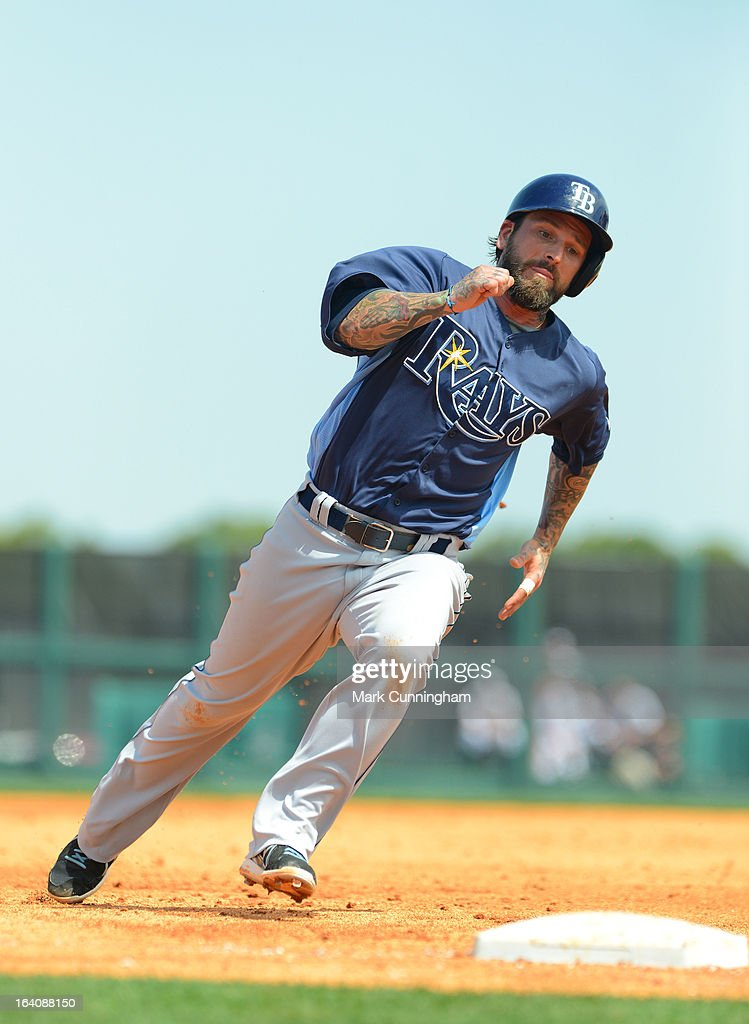 Ryan Roberts #19 of the Tampa Bay Rays runs the bases during the spring training game against the Detroit Tigers at Joker Marchant Stadium on March 19, 2013 in Lakeland, Florida. The Rays defeated the Tigers 11-5.