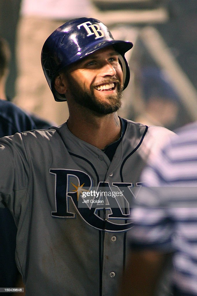 Ryan Roberts #19 of the Tampa Bay Rays smiles as he high-fives teammates in the dugout after scoring against the Los Angeles Angels of Anaheim in the fourth inning at Angel Stadium of Anaheim on August 17, 2012 in Anaheim, California.