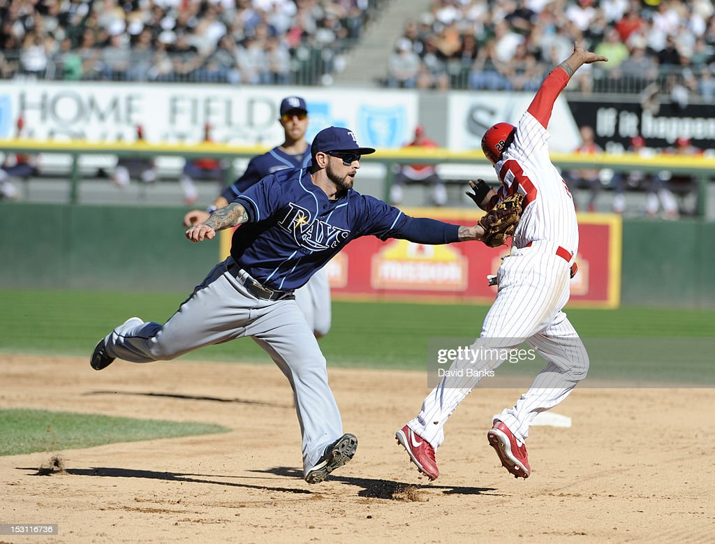 Ryan Roberts #19 of the Tampa Bay Rays tags out <a gi-track='captionPersonalityLinkClicked' href=/galleries/search?phrase=Dewayne+Wise&family=editorial&specificpeople=704740 ng-click='$event.stopPropagation()'>Dewayne Wise</a> #28 of the Chicago White Sox in the fifth inning on September 30, 2012 at U.S. Cellular Field in Chicago, Illinois.