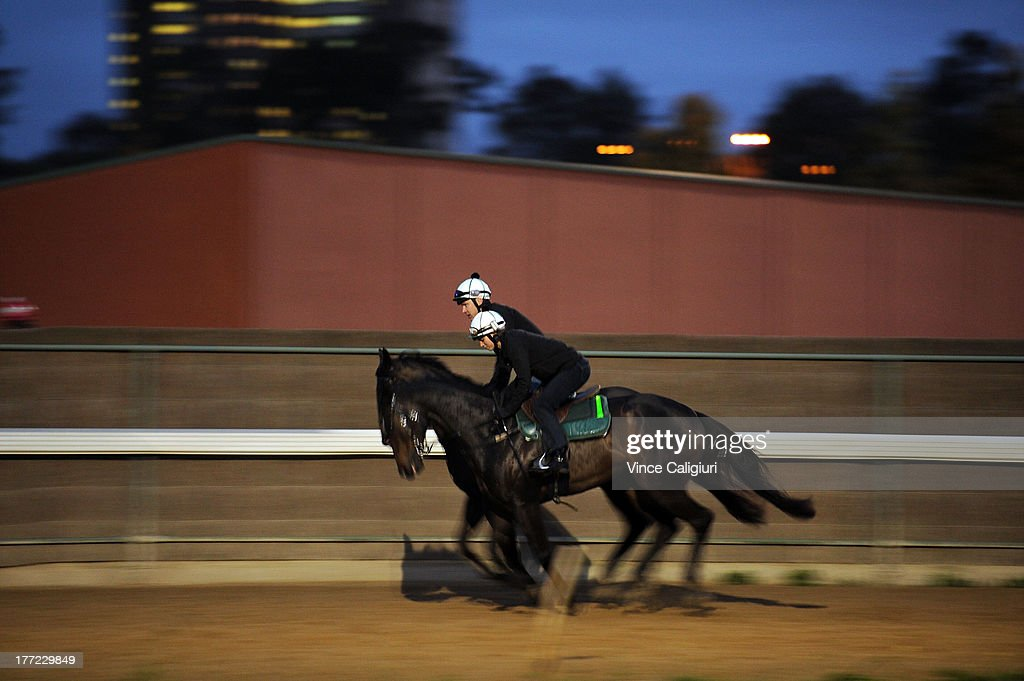 Ryan Roberts riding 3yr old Gregers (back) and Kayla Nisbet riding Spacecraft from the David Hayes stable during a Flemington trackwork session at Flemington Racecourse on August 23, 2013 in Melbourne, Australia.