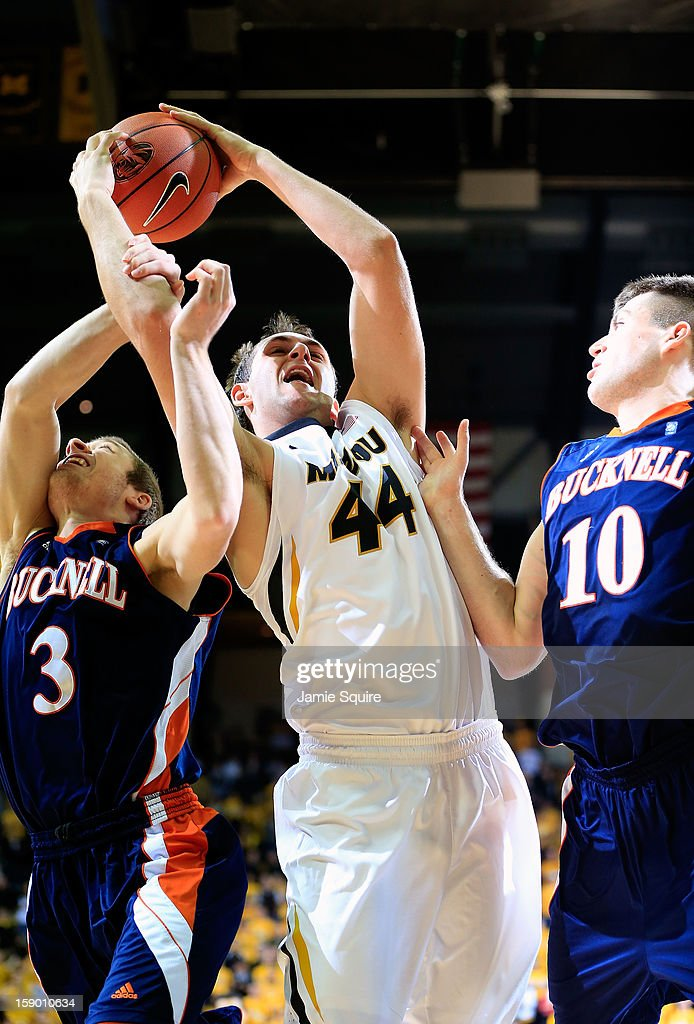 Ryan Rosburg #44 of the Missouri Tigers grabs a rebound over Steven Kaspar #3 and Brian Fitzpatrick #10 of the Bucknell Bison during the game at Mizzou Arena on January 5, 2013 in Columbia, Missouri.