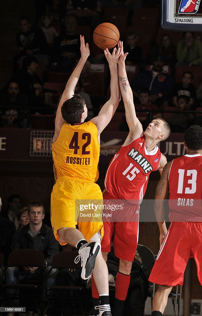 Ryan Rossiter #42 of the Canton Charge shoots the ball against Micah Downs #15 of the Maine Red Claws at the Canton Memorial Civic Center on November 23, 2012 in Canton, Ohio.