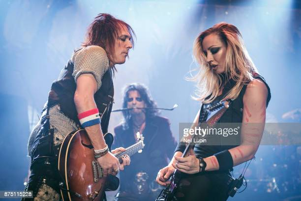Ryan Roxie and Nita Strauss perform with Alice Cooper at Wembley Arena on November 16 2017 in London England