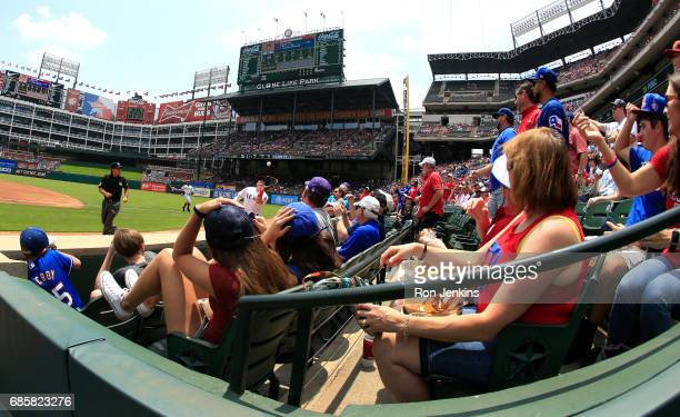 Ryan Rua of the Texas Rangers catches foul ball for an out against the Philadelphia Phillies during the first inning at Globe Life Park in Arlington...