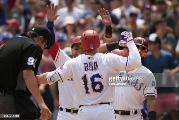 Ryan Rua of the Texas Rangers celebrates with teammates following his threerun home run against the Philadelphia Phillies during the fifth inning at...