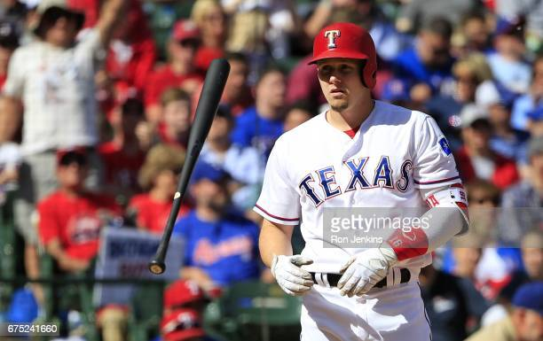 Ryan Rua of the Texas Rangers flips his bat after striking out against the Los Angeles Angels of Anaheim to end the seventh inning at Globe Life Park...