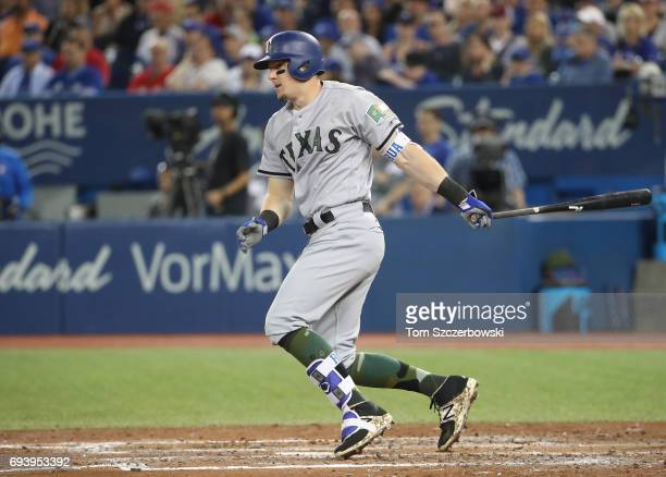 Ryan Rua of the Texas Rangers hits a double in the fourth inning during MLB game action against the Toronto Blue Jays at Rogers Centre on May 27 2017...
