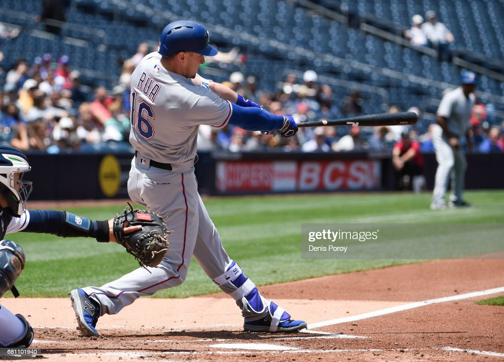 Ryan Rua #16 of the Texas Rangers hits a three-run home run during the first inning of a baseball game against the San Diego Padres at PETCO Park on May 9, 2017 in San Diego, California.