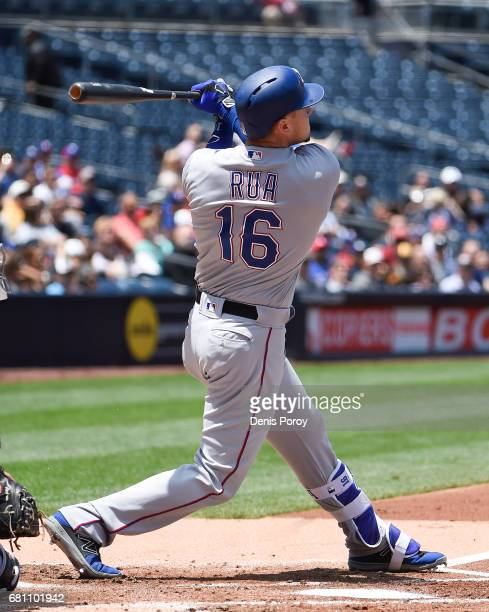 Ryan Rua of the Texas Rangers hits a threerun home run during the first inning of a baseball game against the San Diego Padres at PETCO Park on May 9...