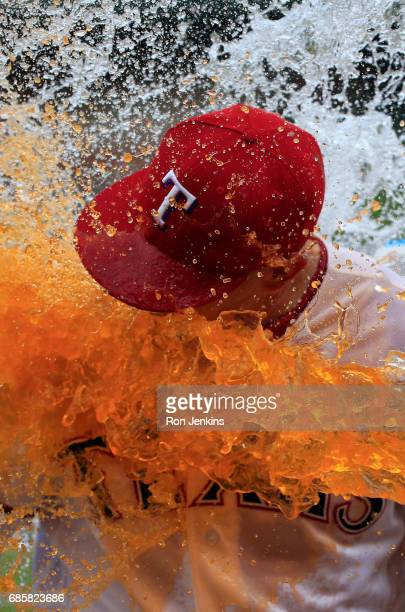 Ryan Rua of the Texas Rangers is doused with Powerade by teammates following the Rangers game with the Philadelphia Phillies at Globe Life Park in...