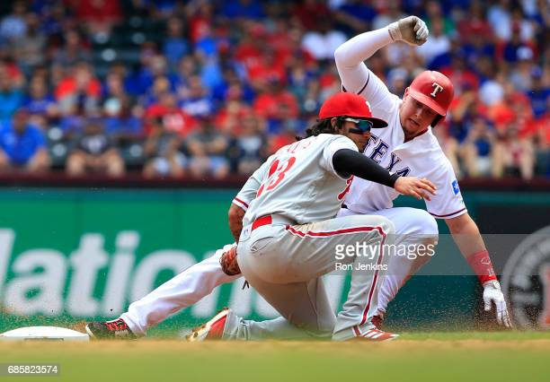 Ryan Rua of the Texas Rangers is tagged out by Freddy Galvis of the Philadelphia Phillies to end the second inning at Globe Life Park in Arlington on...