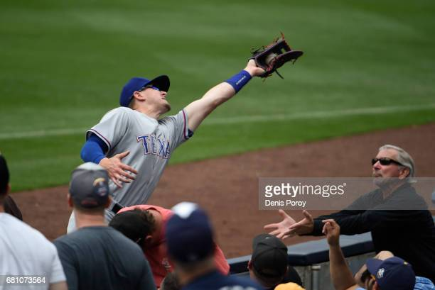 Ryan Rua of the Texas Rangers makes the catch on a foul ball hit by Austin Hedges of the San Diego Padres during the fifth inning of a baseball game...