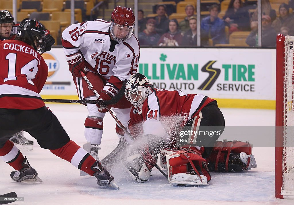 Ryan Ruck #41 of Northeastern University saves a shot by Ryan Donato #16 of Harvard University during the third period of the Beanpot Tournament consolation game at TD Garden on February 8, 2016 in Boston, Massachusetts.