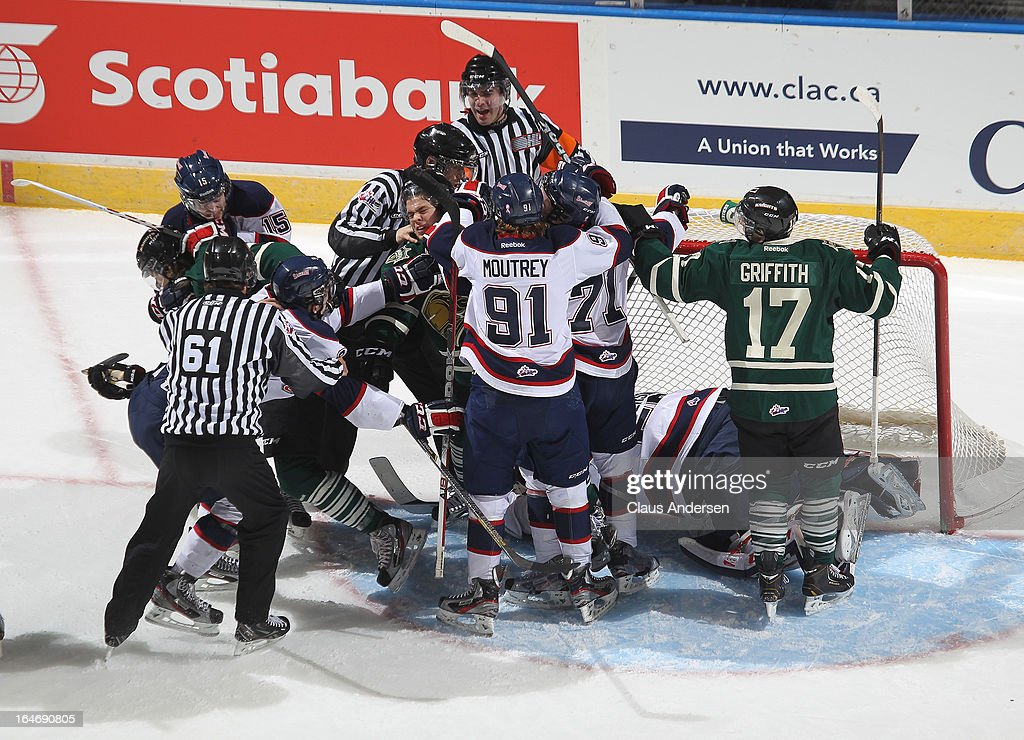 Ryan Rupert #64 of the London Knights finds himself in the middle of a scrum in a 1st round play-off game against the Saginaw Spirit on March 22, 2013 at the Budweiser Gardens in London, Ontario, Canada. The Knights defeated the Spirit 5-2 to take a 1-0 series lead.
