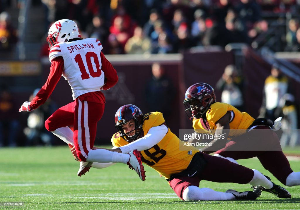 Ryan Santoso #18 of the Minnesota Golden Gophers attempts the tackle on JD Spielman #10 of the Nebraska Cornhuskers in the fourth quarter against the Minnesota Golden Gophers at TCF Bank Stadium on November 11, 2017 in Minneapolis, Minnesota. Minnesota defeated Nebraska 54-21.