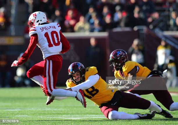 Ryan Santoso of the Minnesota Golden Gophers attempts the tackle on JD Spielman of the Nebraska Cornhuskers in the fourth quarter against the...