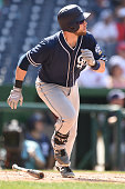 Ryan Schimpf of the San Diego Padres runs to first base during a baseball game against the Washington Nationals at Nationals Park on July 24 2016 in...